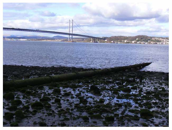 Photograph 3.11: The Ferry Burn outfall discharging into the Firth of Forth