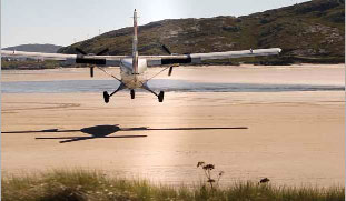 Twin Otter aircraft landing on Traigh Mhor beach at Barra