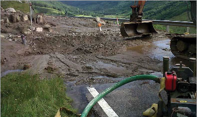 Clearing up a landslide on the A83 (Courtesy of Scotland Transerv)