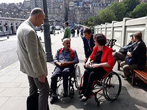 MACS Turkish visit - talking about wheelchairs near Waverley Station