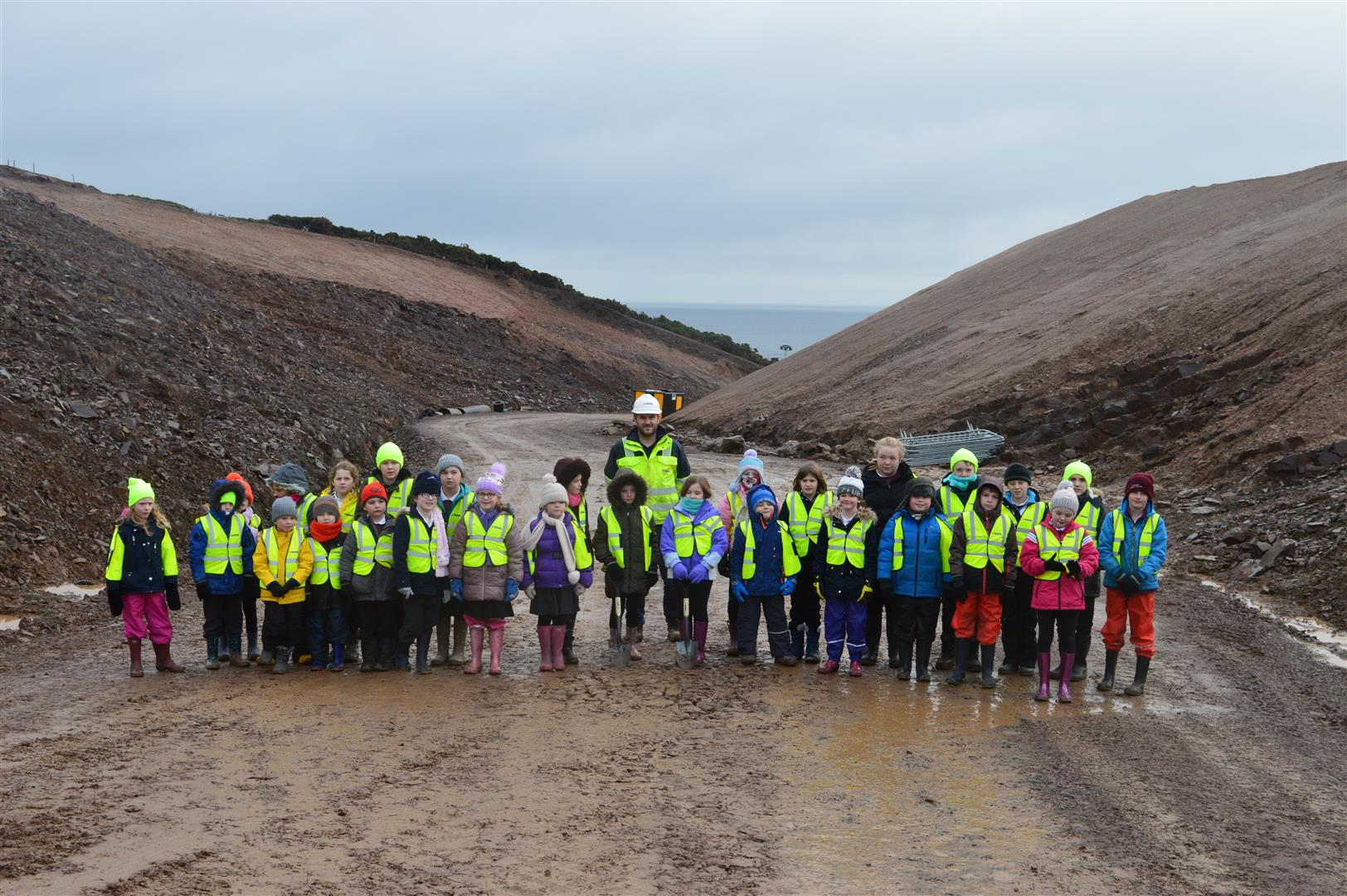 Schoolchildren standing at the A9 Berriedale Project