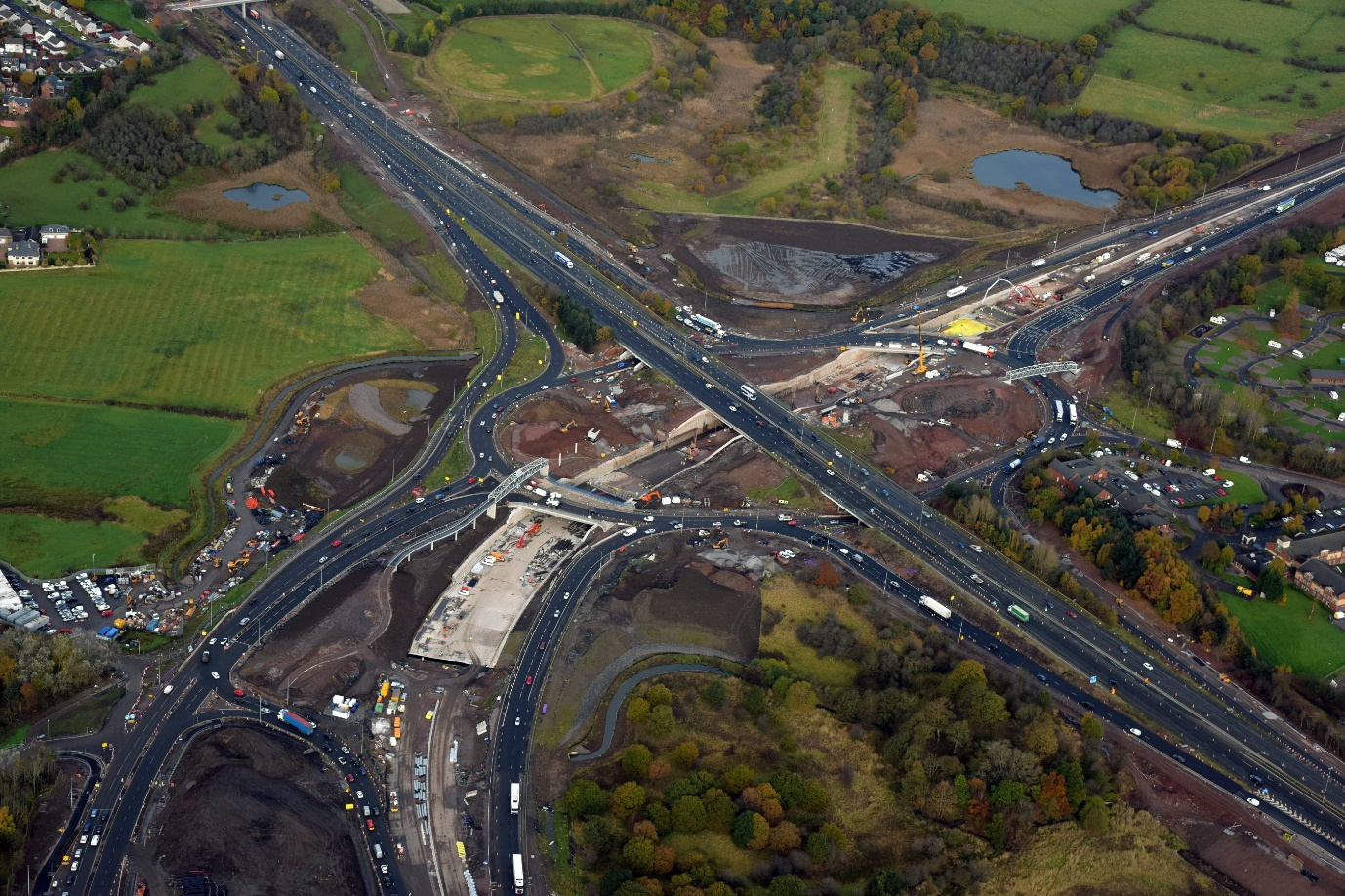 Aerial view of Raith Junction during construction circa Dec 2016, showing completion of piling and emergence of the A725 underpass below the M74