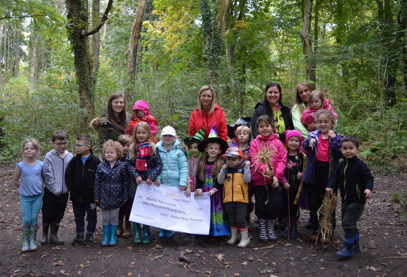 Scottish Roads Partnership presented Muddy Adventures with a bumper cheque for £1,000 from its Good Neighbour Fund
